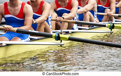 Mens Eight rowing team at the start of a regatta