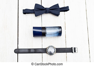 Men's fashion accessories on a white wooden background. Flat lay