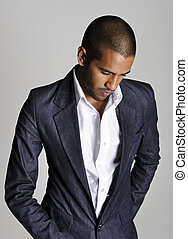 Attractive Indian fashion model with suit in studio