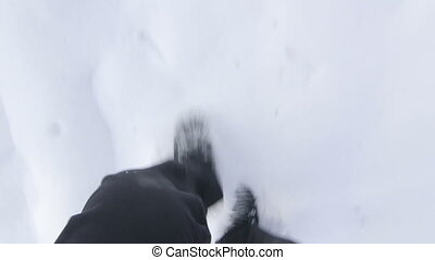 Men's feet running in the snow  POV