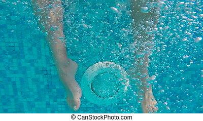 men's feet underwater in the pool move