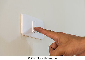 open the light switch on the wall.