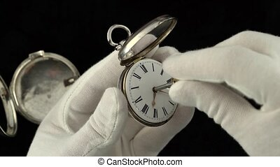 Men's gloved hands hold a pocket watch and customize them....