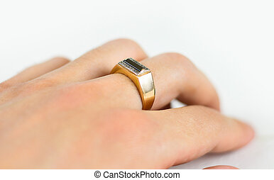 Men's gold ring with diamonds on the hand