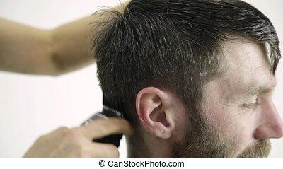 Mens haircut at barbershop. Female hairdresser shaping mens...