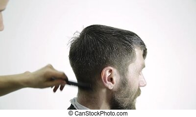Mens haircut at barbershop. Female hairdresser shaping mens...