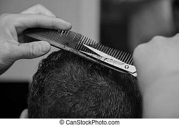 Men's haircut at the barber scissors