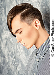 mens hairdresser - Portrait of a young man with fashionable...