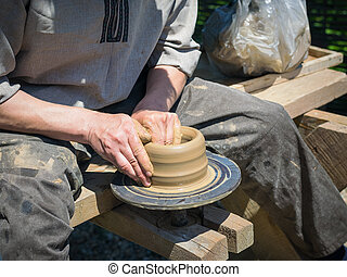 Mens hand made pottery clay old-fashioned way.