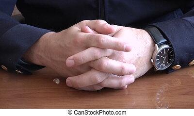 Men's hands clasped in castle