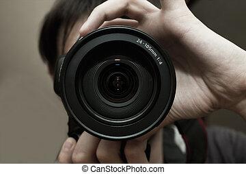 Men's hands held camera closeup