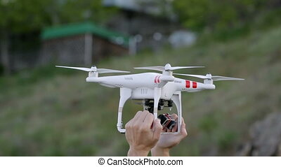 Men's hands hold drone. operator calibrates quadrocopter...