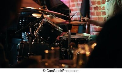 Men's hands in the frame, playing the drums, close up