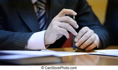 Men's Hands On The Table. Business