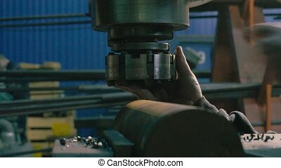 Men's hands replacing milling cutter - Close up of men's...