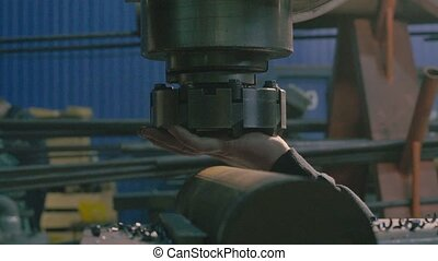 Men's hands replacing milling cutter - Close up of men's...