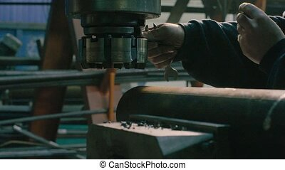 Men's hands screwing the milling cutter - Close up of men's...