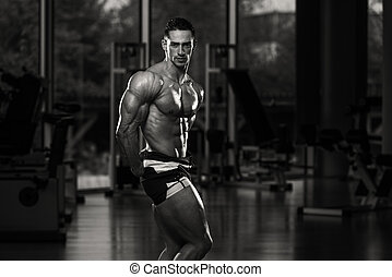 Men`s Health - Serious Men Standing In The Gym And Flexing ...