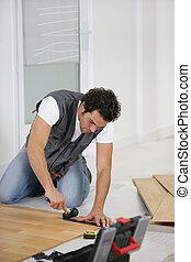 mens het leggen, een, houtenvloer