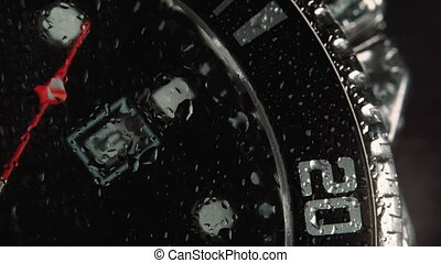 Mens Japanese Chronograph made metal with sapphire glass. Wrist watch - slow motion, time passing slowly - beautiful macro shot with little drops of water on the glass.