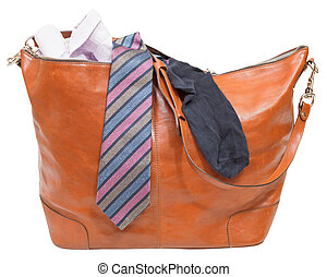 men's leather bag with shirt, tie, sock isolated