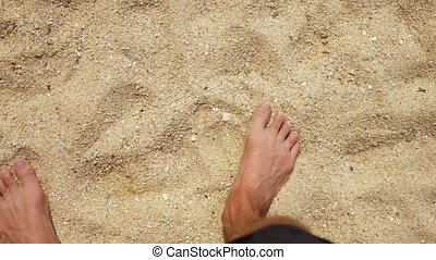 Men's Legs on the sea sand and wave, Relaxation on the ocean...