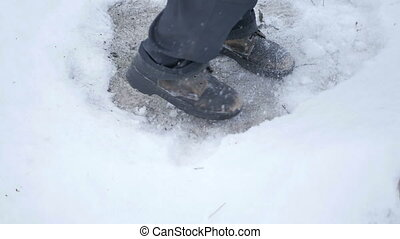 Men's old shoes in the snow
