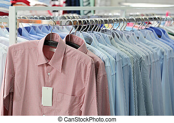 Mens plaid shirts on hangers in a retail store