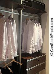 Mens shirts wardrobe - Mens white business shirts organized...