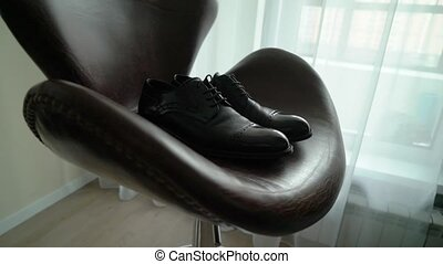 Men's shoes. Close up of black leather men's shoes. Stylish black shoes for the groom.