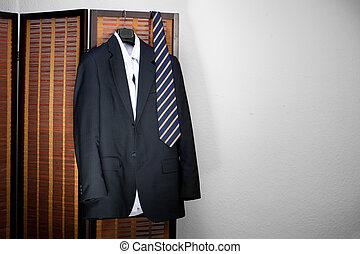 Mens suit hanging on hangers - suit hanging on hangers
