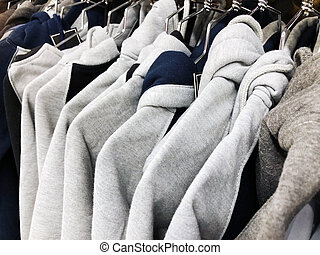 Mens sweaters on the hanger in the store.