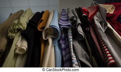 Men's T-shirts on hangers at wardrobe