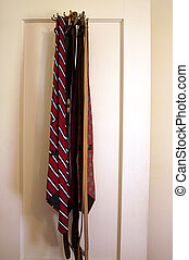Mens Ties and Belts Hanging on Door Rack