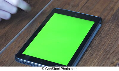 Men's Using Tablet PC with Green Screen on Wooden Table With Various Hand Gestures