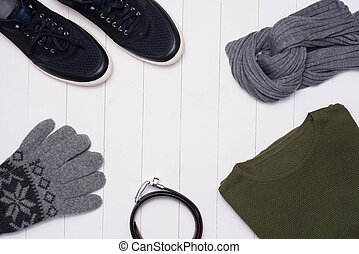 Men's winter casual outfits with accessories on wooden background