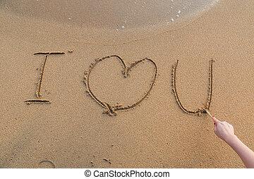 mensaje, te amo, arena, con, mujer, mano, dibujo