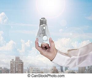 menschliche hand, besitz, glühlampe