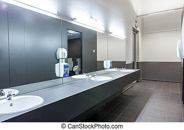 Mensroom - in the men's room there's a cave mirror on the...
