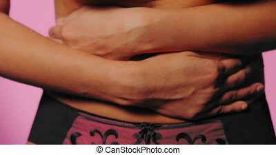 Woman belly with hands on it. Pain concept while menstruation.