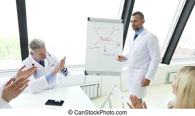 Team of doctors discuss mental health conceptual presentation in clinical office