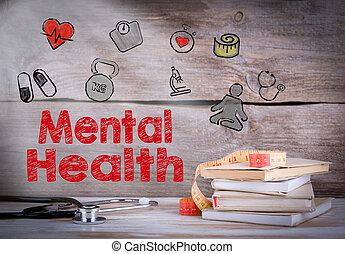 Mental Health. Stack of books and a stethoscope on a wooden background