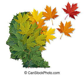 Mental illness and Alzheimer's disease as a health care and medical symbol with a human head made of green leaves turning to falling autumn foliage lost in to the wind.