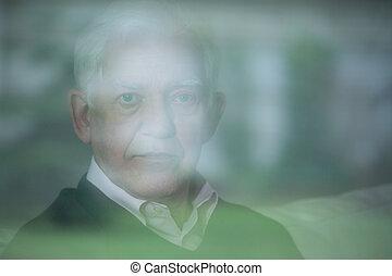 Mental illness in the elderly - Portrait of elderly man with...