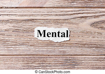 mental of the word on paper. concept. Words of mental on a wooden background