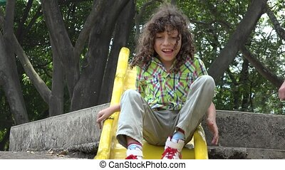 Mentally Disabled Boy on Slide