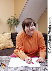 Mentally disabled woman painted hearts - Mentally disabled...