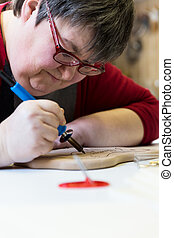 mentally disabled woman wirh burning pen - mentally disabled...