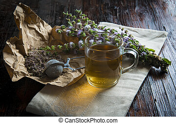 Mentha pulegium infusion on a wooden table
