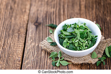 Menthol leaves - Old wooden table with some fresh Menthol...